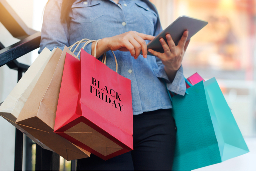 black friday shopping with a woman searching Facebook for sale info